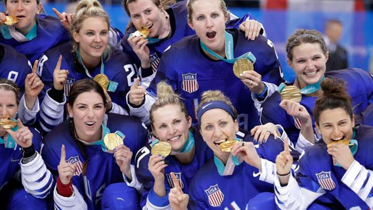 Untied States hockey team celebrate with their gold medals after beating Canada in the womens gold medal hockey game at the 2018 Winter Olympics in South Korea, Feb. 22, 2018.
