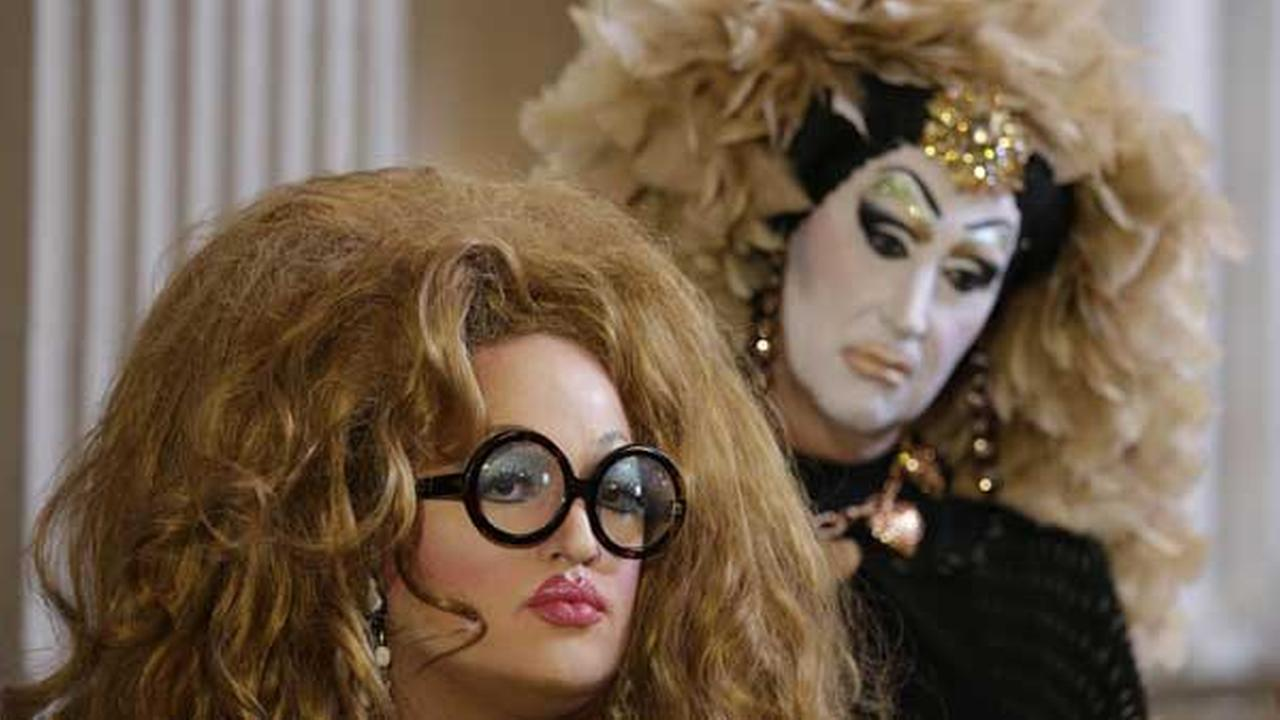 Drag queens Lil Ms. Hot Mess, left, and Sister Roma, right, listen to comments about their battle with Facebook during a news conference at City Hall Wednesday, Sept. 17, 2014.
