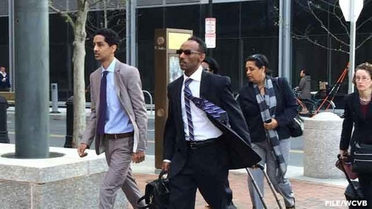 FILE: Robel Phillipos (left) arrives in court in 2014.