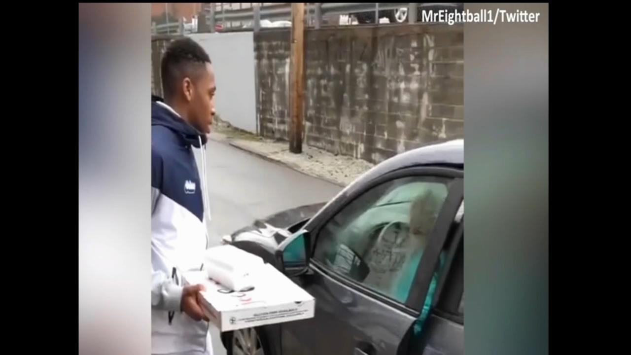 College basketball player delivers food to woman living in car