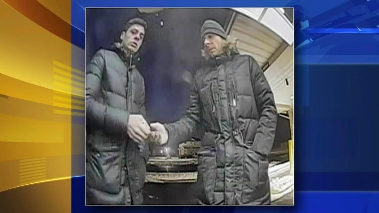 Surveilance video catches two suspects placing card skimmers on ATM