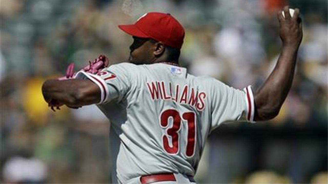 Philadelphia Phillies Jerome Williams delivers against the Oakland Athletics in the first inning of a baseball game Saturday, Sept. 20, 2014, in Oakland, Calif.
