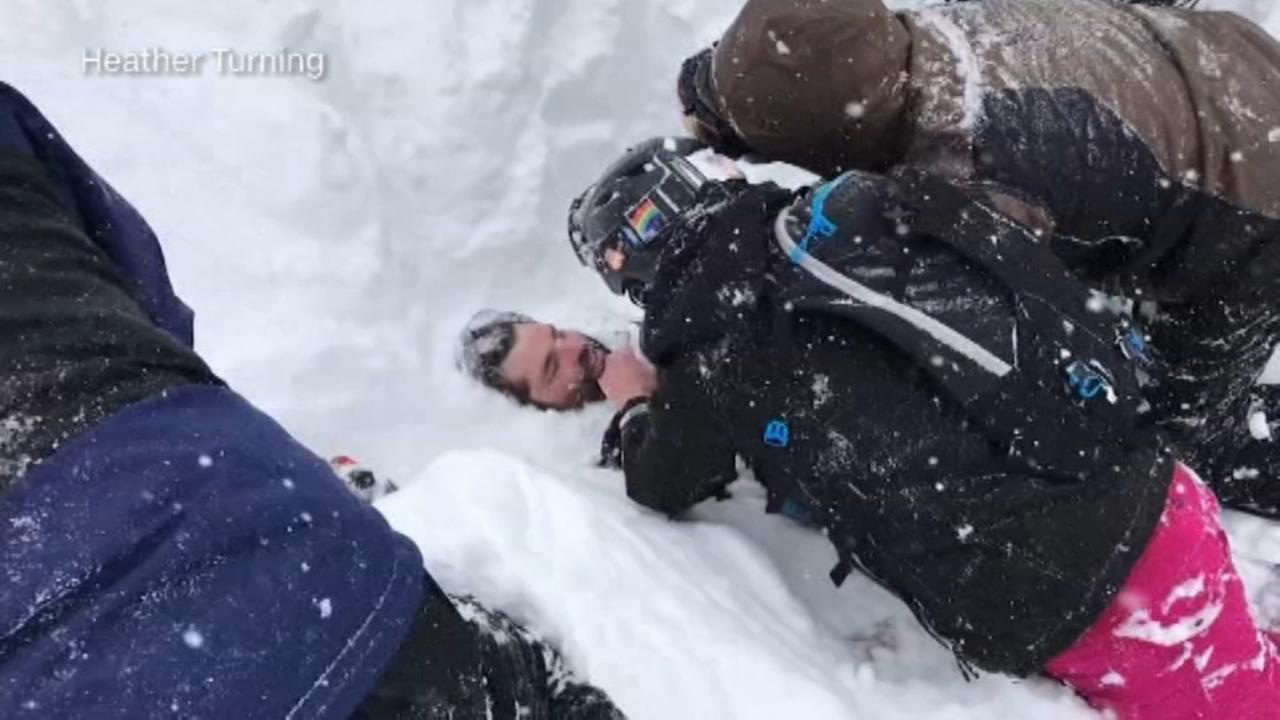 Skiers dig out avalanche victim