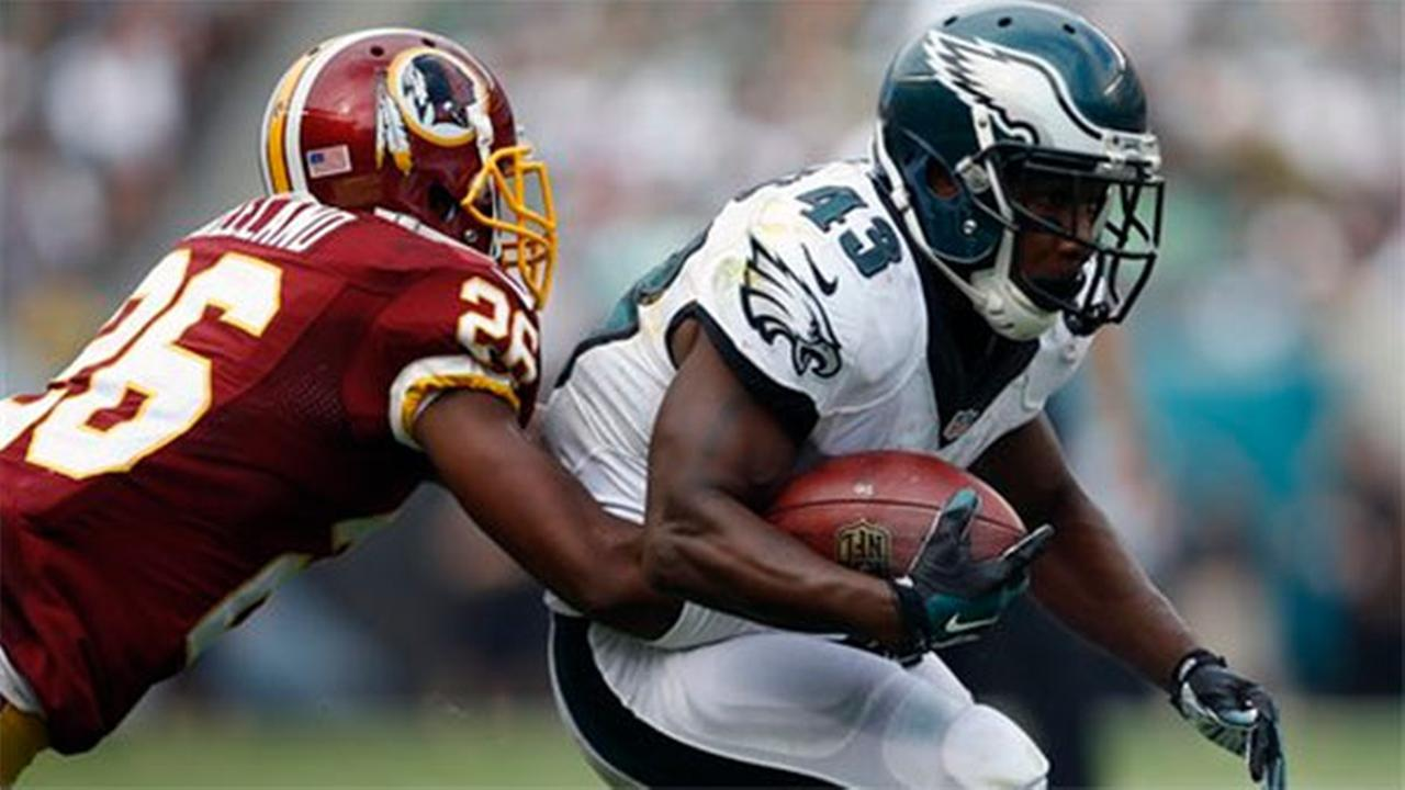 Philadelphia Eagles Darren Sproles (43) is tackled by Washington Redskins strong safety Bashaud Breeland (26), Sunday, Sept. 21, 2014, in Philadelphia.
