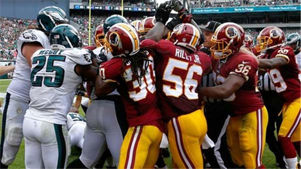 Officials try to break up a scuffle between the Washington Redskins and Philadelphia Eagles, Sunday, Sept. 21, 2014, in Philadelphia.