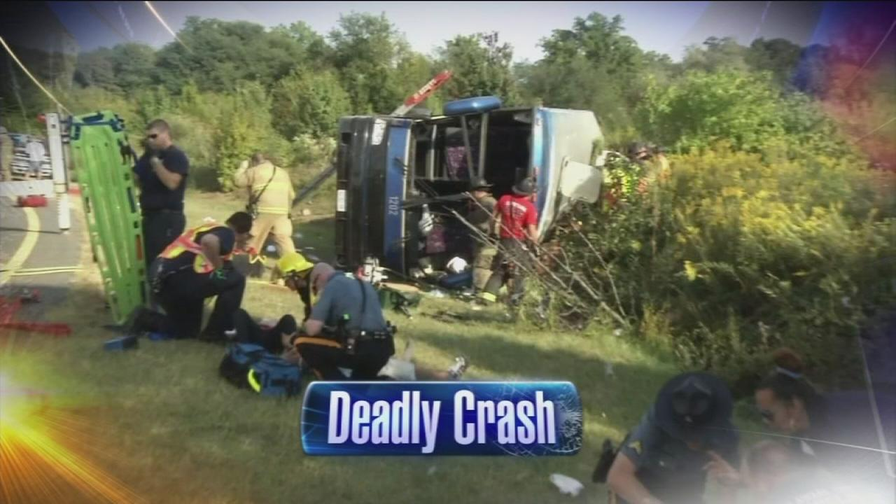 VIDEO: 1 dead, dozens injured when tour bus overturns