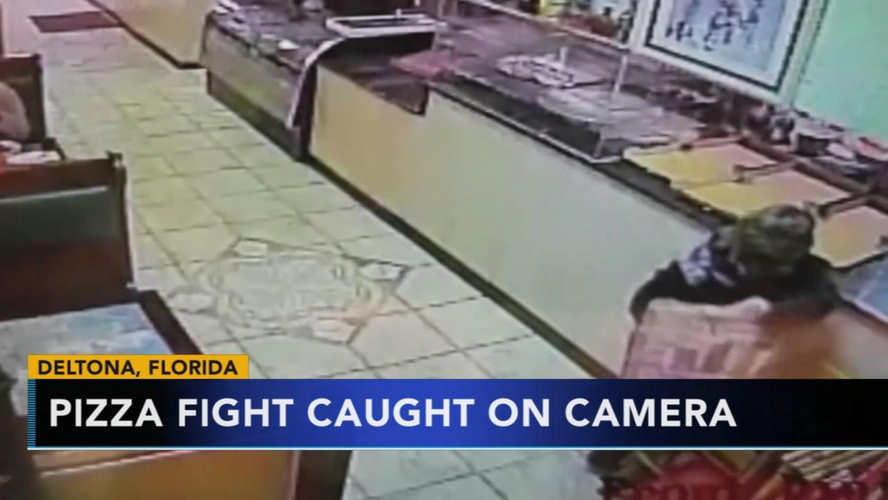 Woman arrested after pizza fight caught on camera