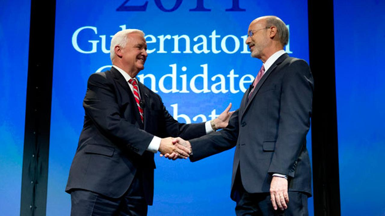 Republican Gov. Tom Corbett, left, and Democrat Tom Wolf shake hands at the end of a gubernatorial debate hosted by the Pennsylvania Chamber of Business and Industry..