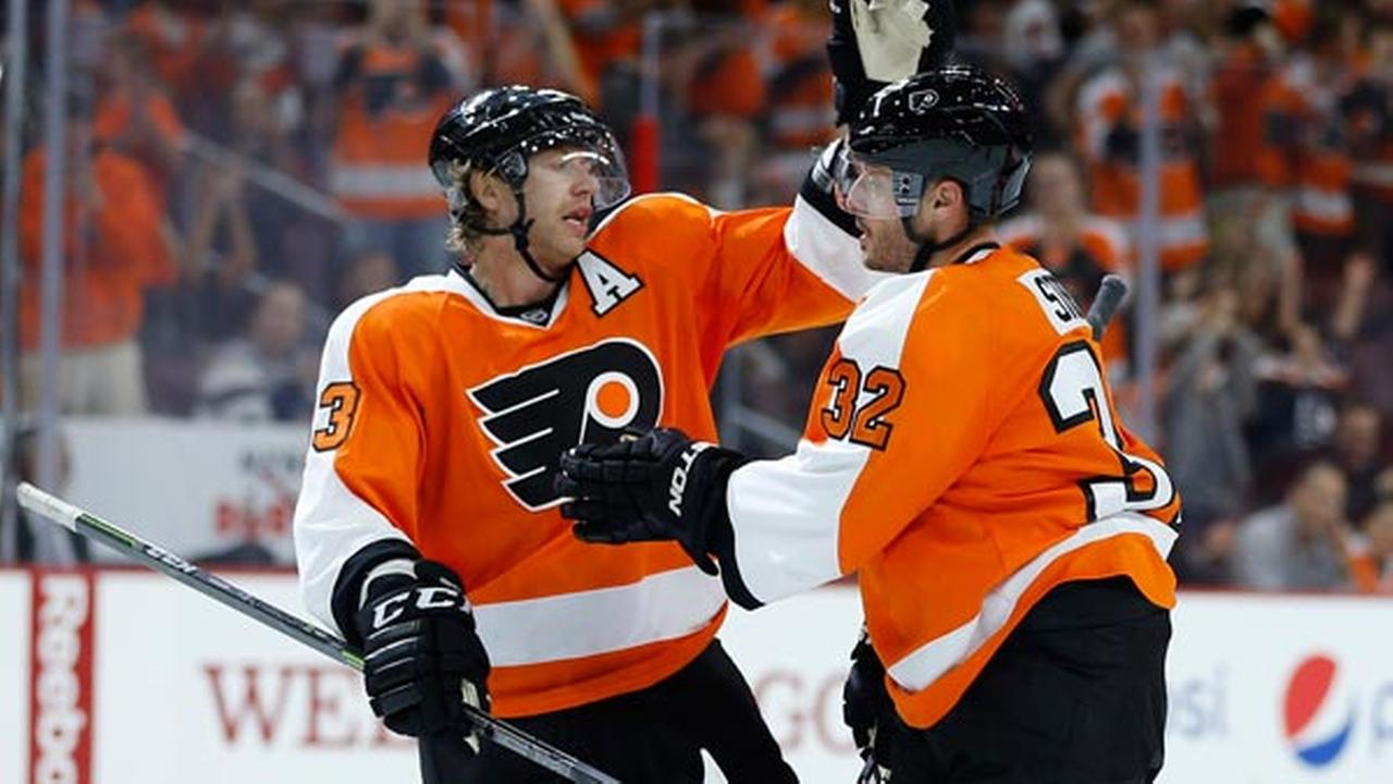 Philadelphia Flyers Mark Streit, right, and Jakub Voracek celebrate after Streits goal during the second period of a preseason NHL hockey game.