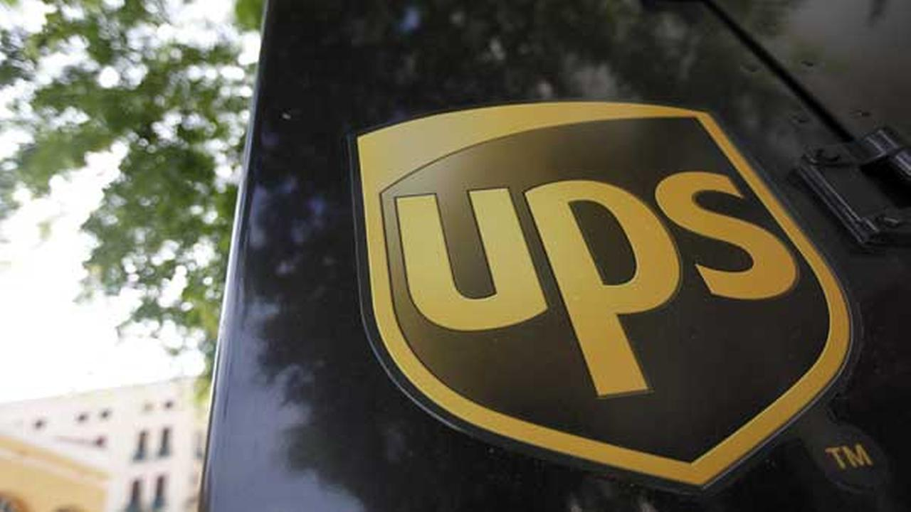 An UPS truck is parked outside of a business, Tuesday, July 17, 2012, in Coral Gables, Fla. (AP Photo/Lynne Sladky)