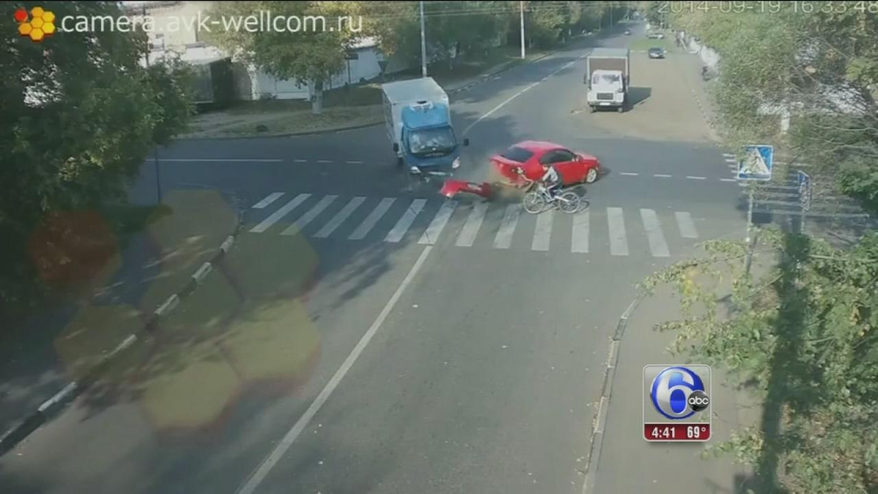 VIDEO: Bicyclist narrowly avoids death in crash