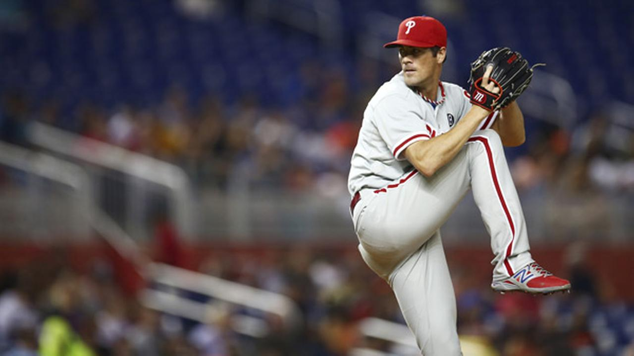 Philadelphia Phillies starter Cole Hamels pitches to the Miami Marlins during the first inning of a baseball game in Miami, Tuesday, Sept. 23, 2014. (AP Photo/J Pat Carter)
