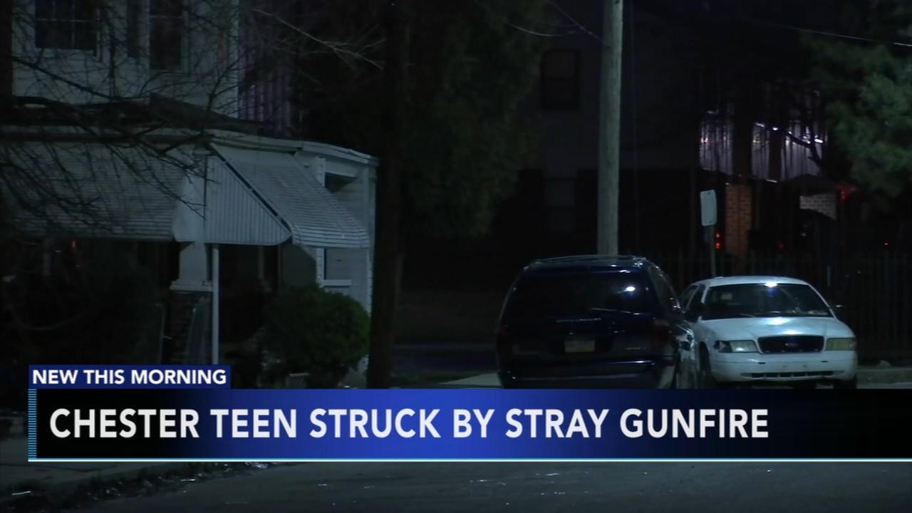 Teen hit by stray gunfire