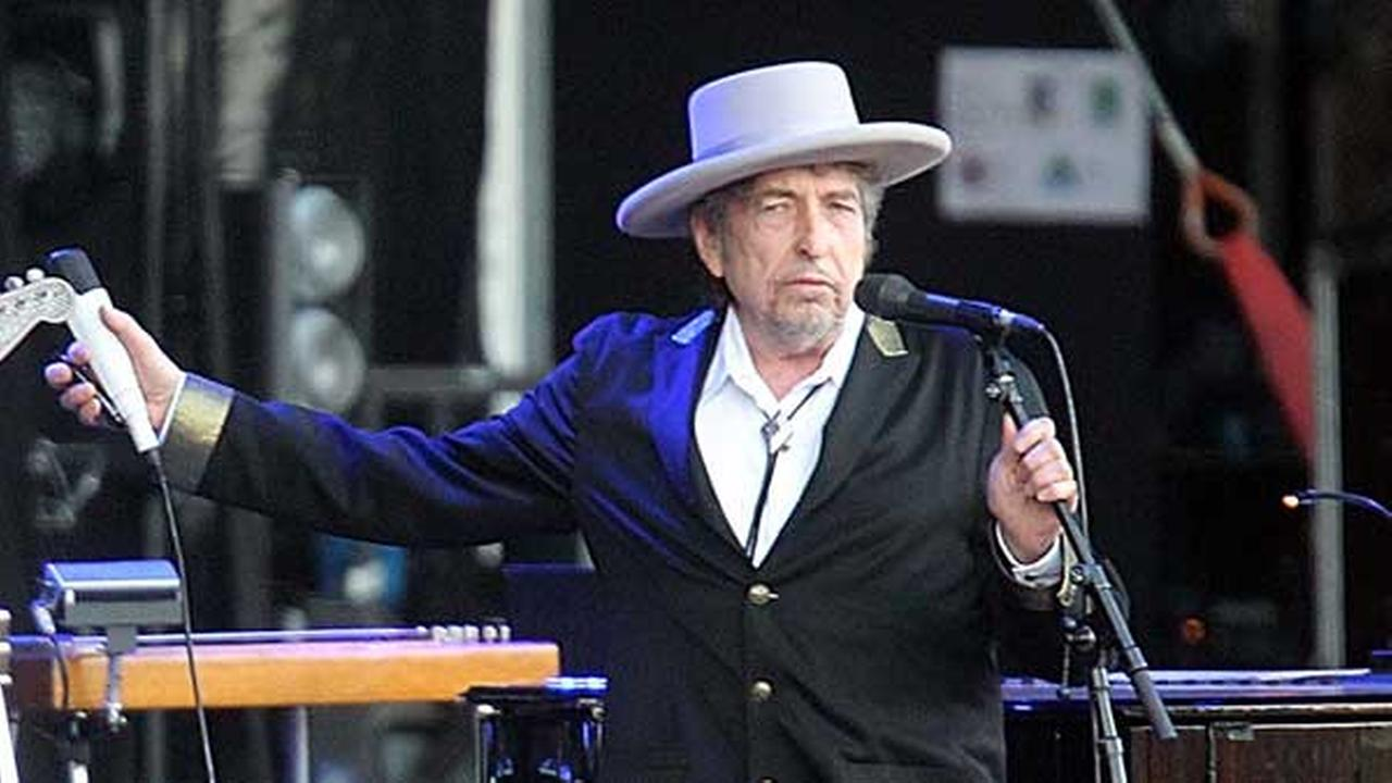 FILE - This July 22, 2012 file photo shows U.S. singer-songwriter Bob Dylan performing on stage at Les Vieilles Charrues Festival in Carhaix, western France.