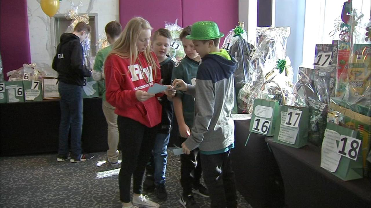 Kids receive gifts at Little Heros Gala
