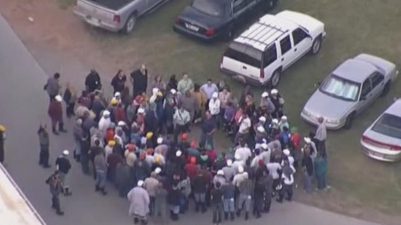 Police responded to a suburban Oklahoma City food distribution center where a woman was beheaded by a co-worker.