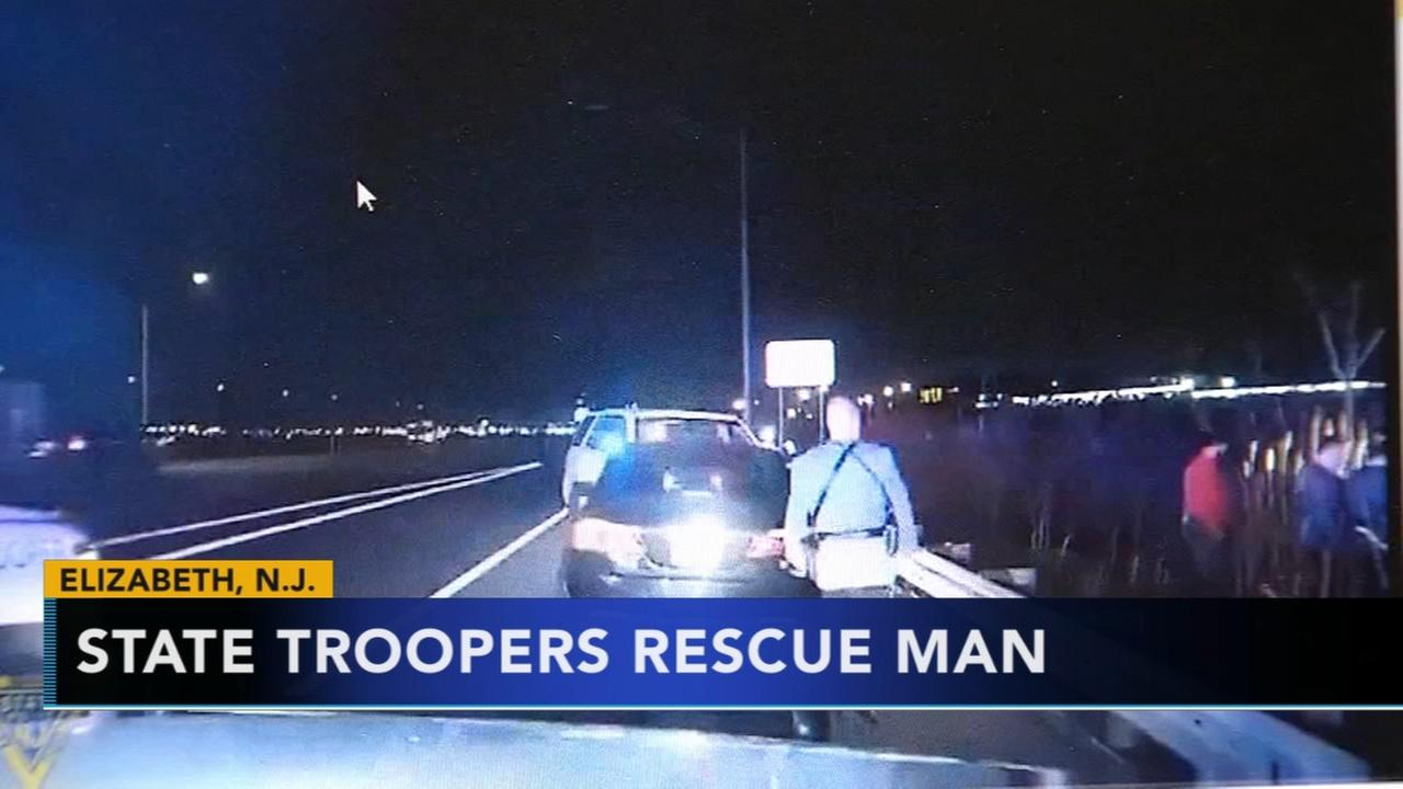 NJ state troopers rescue man stuck in swamp