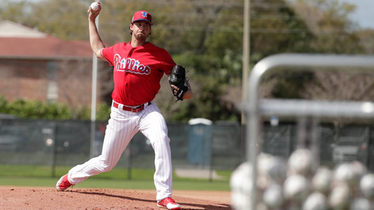 Philadelphia Phillies starting pitcher Aaron Nola throws during batting practice at baseball spring training camp, Tuesday, Feb. 20, 2018, in Clearwater, Fla.