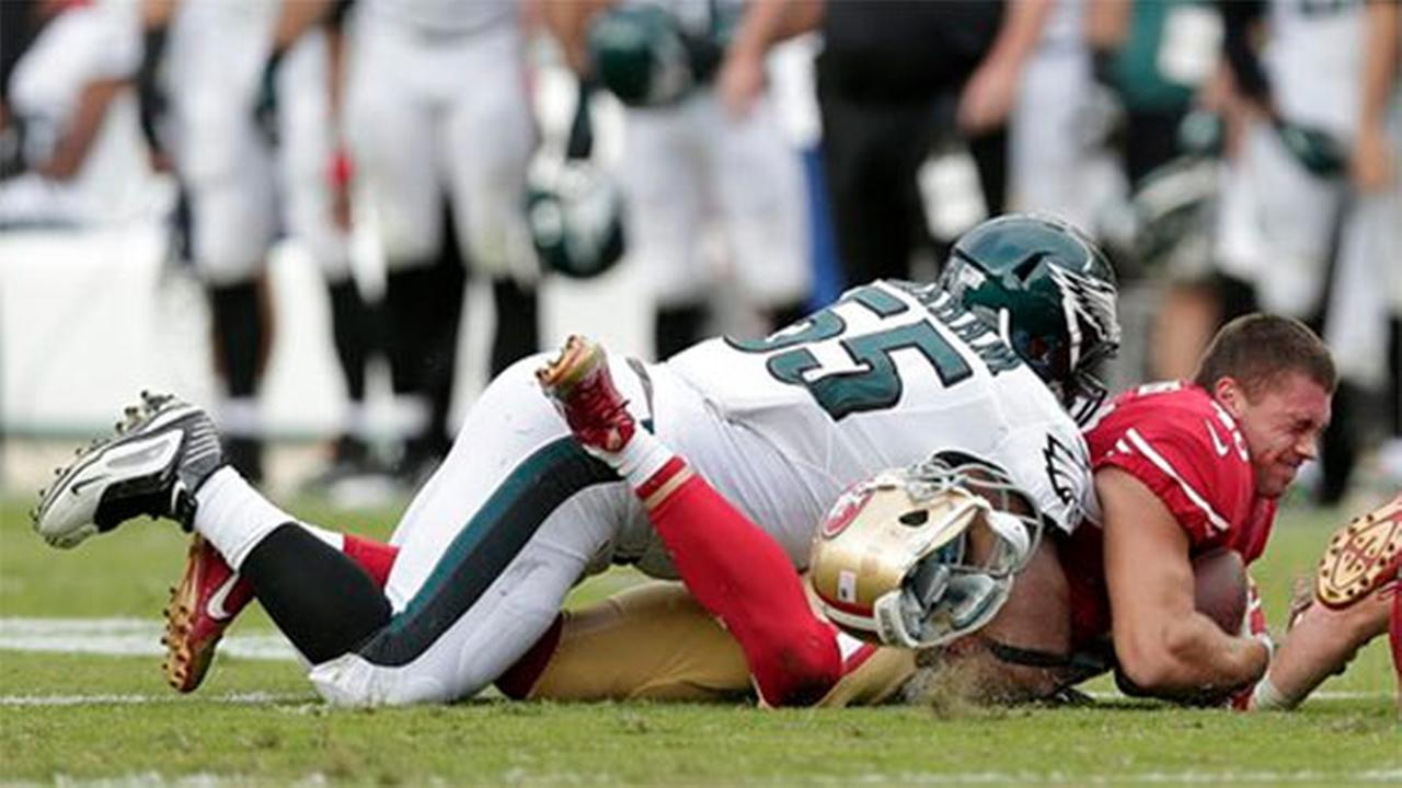 San Francisco 49ers tight end Derek Carrier (46) is tackled by Philadelphia Eagles linebacker Brandon Graham (55), Sunday, Sept. 28, 2014.
