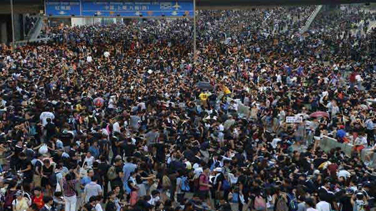 Pro-democracy protesters flood the Central financial district in Hong Kong Monday, Sept. 29, 2014.