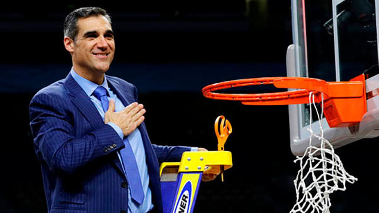 Villanova head coach Jay Wright reacts after cutting down the net after beating Michigan 79-62 in the championship game, Monday, April 2, 2018, in San Antonio.