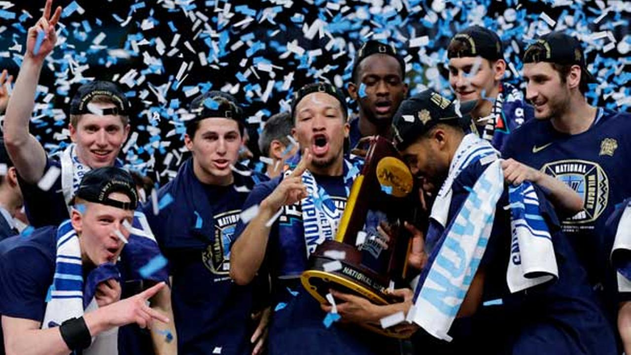 Villanova players celebrate with the trophy after beating Michigan 79-62 in the championship game of the Final Four NCAA college basketball tournament, April 2, 2018.