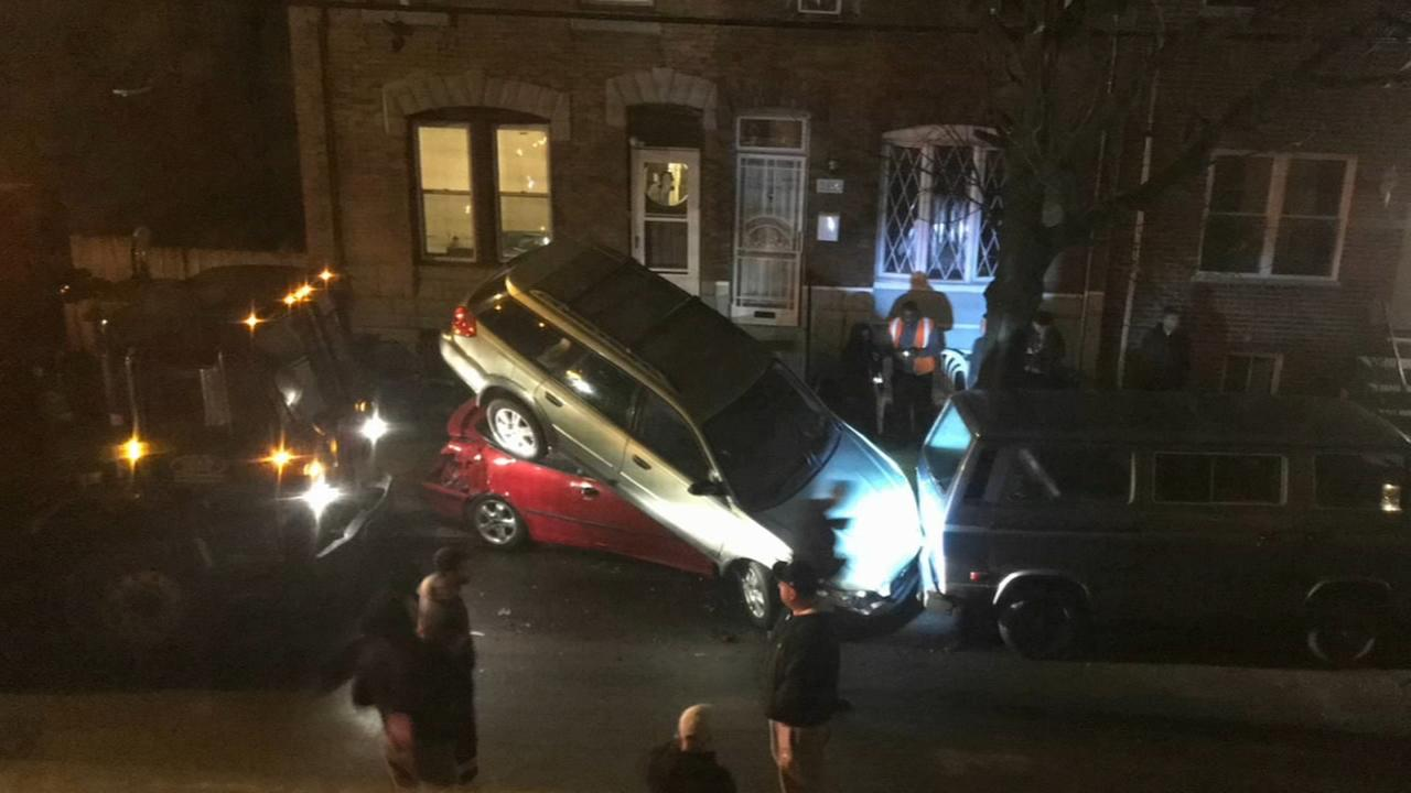 Trash truck crashes into parked cars in Grays Ferry