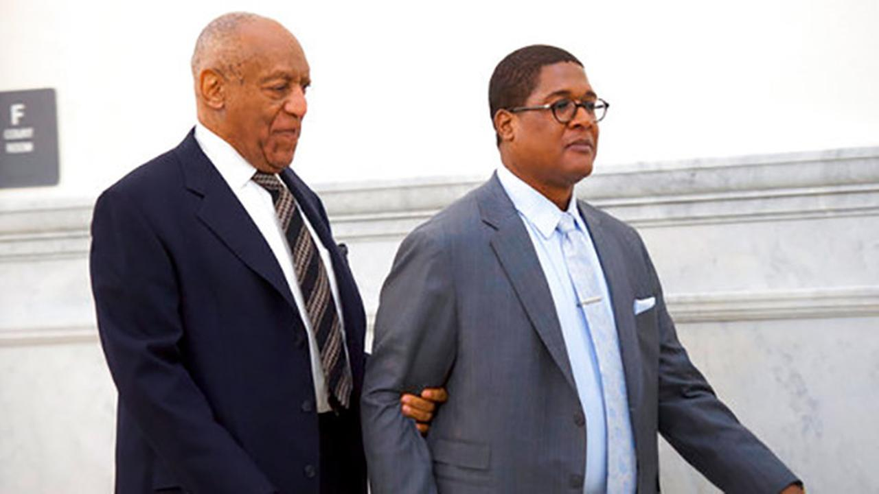 Cosby's lawyers file to get juror tossed