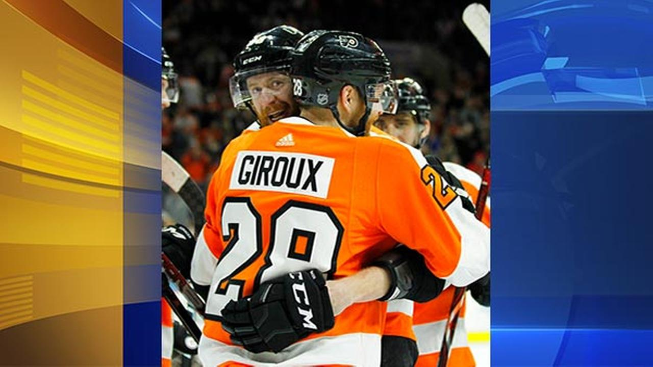 Philadelphia Flyers Jakub Voracek, facing, hugs Claude Giroux after Girouxs goal during the second period of an NHL hockey game against the New York Rangers.