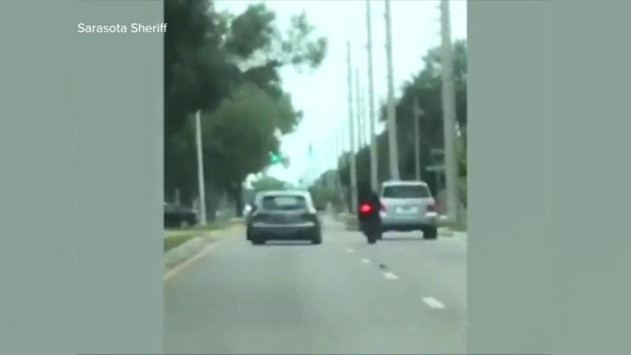 Car rams motorcyclist in suspected road rage incident