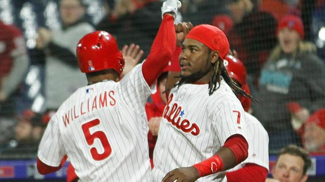 Phillies Nick Williams, left, is greeted at the dugout after hitting a solo home run during the eighth inning against the Cincinnati Reds, April 9, 2018, in Philadelphia.