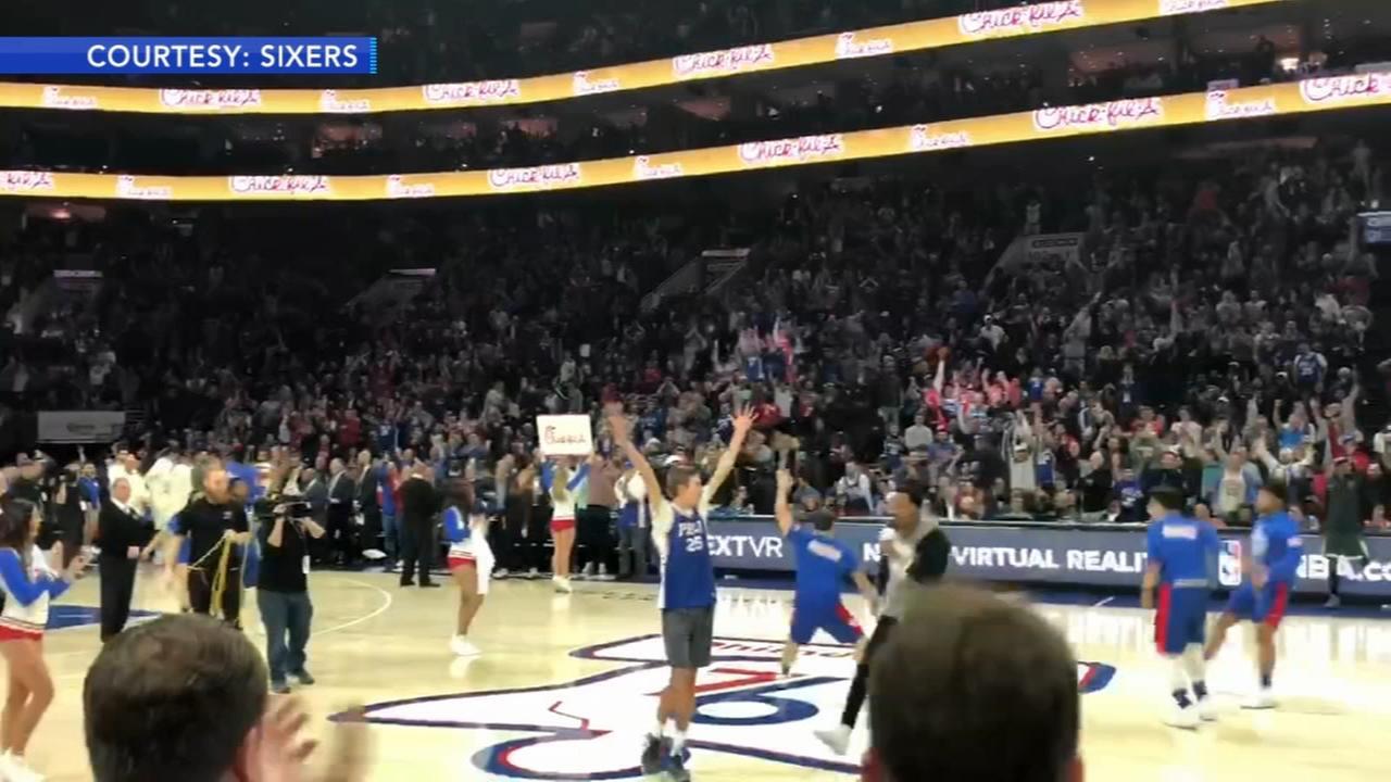 Lifelong 76ers fan makes half-court shot