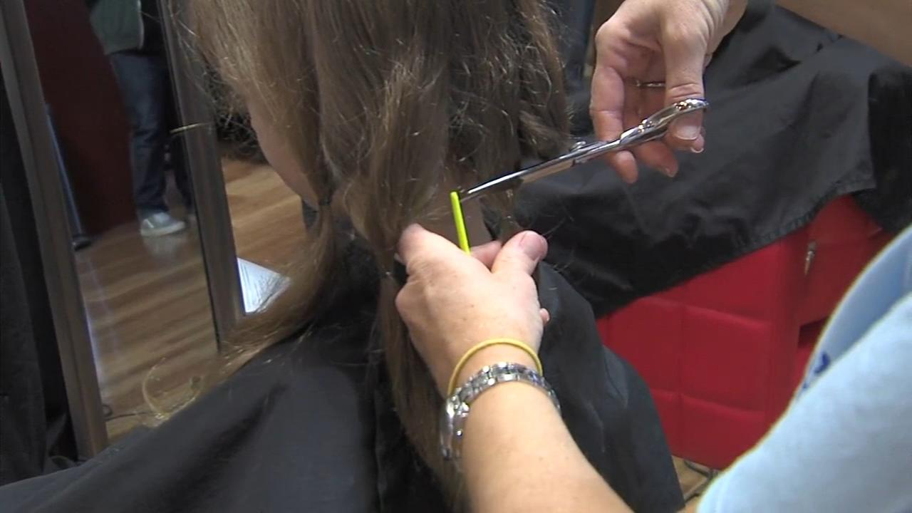 Dozens cut hair to help kids who lost theirs