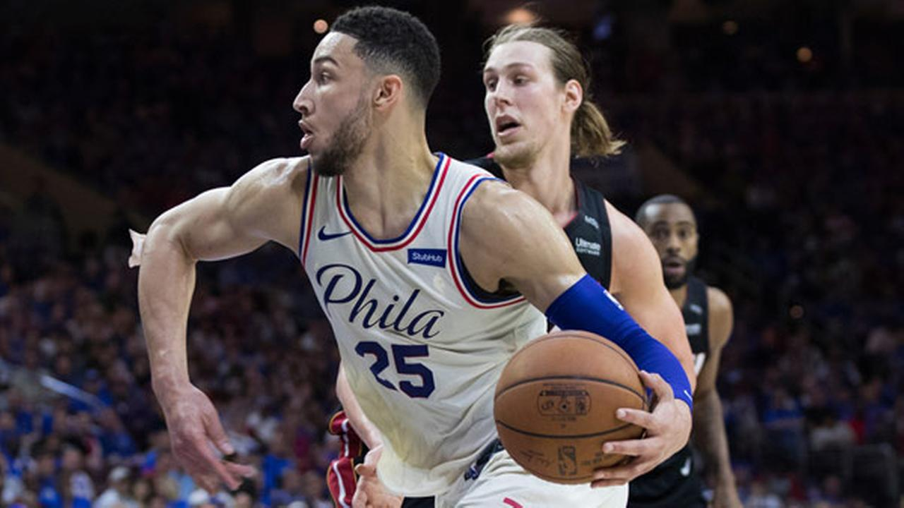 Philadelphia 76ers Ben Simmons drives to the basket past Miami Heats Kelly Olynyk, right, during the second half in Game 1 of a first-round NBA basketball playoff series.