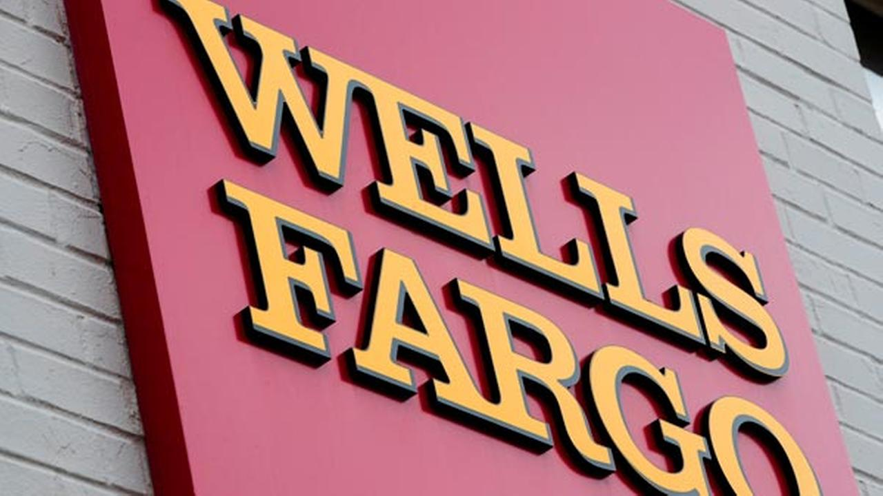 FILE - This Aug. 11, 2017, file photo shows a sign at a Wells Fargo bank location in Philadelphia.