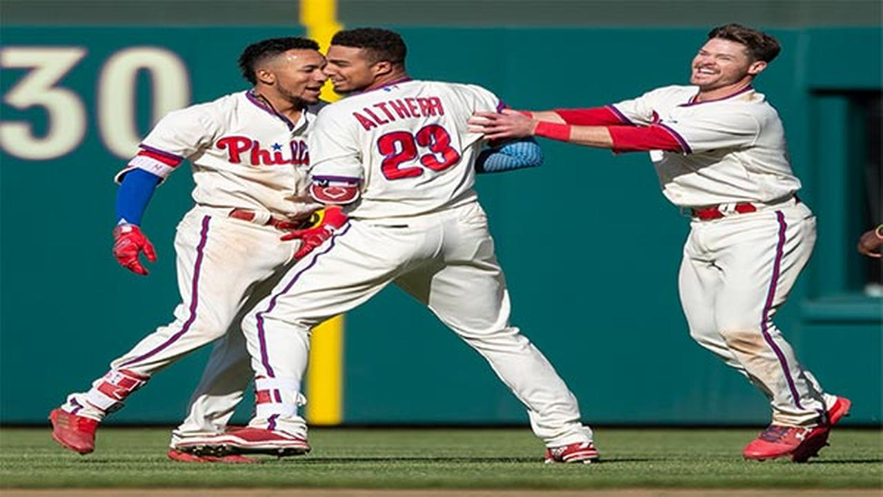 Philadelphia Phillies Aaron Altherr (23) is cheered by teammates after hitting an RBI walk-off single in the 11th inning of a baseball game against the Pittsburgh Pirates.