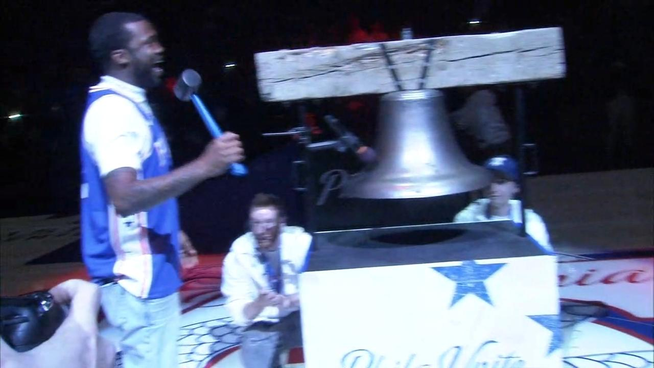 Meek Mill rings the bell at the Philadelphia 76ers playoff game.
