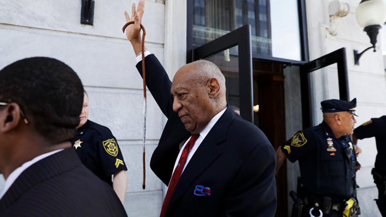 Bill Cosby gestures as he leaves the Montgomery County Courthouse in Norristown, Pa., after being convicted of drugging and molesting a woman.