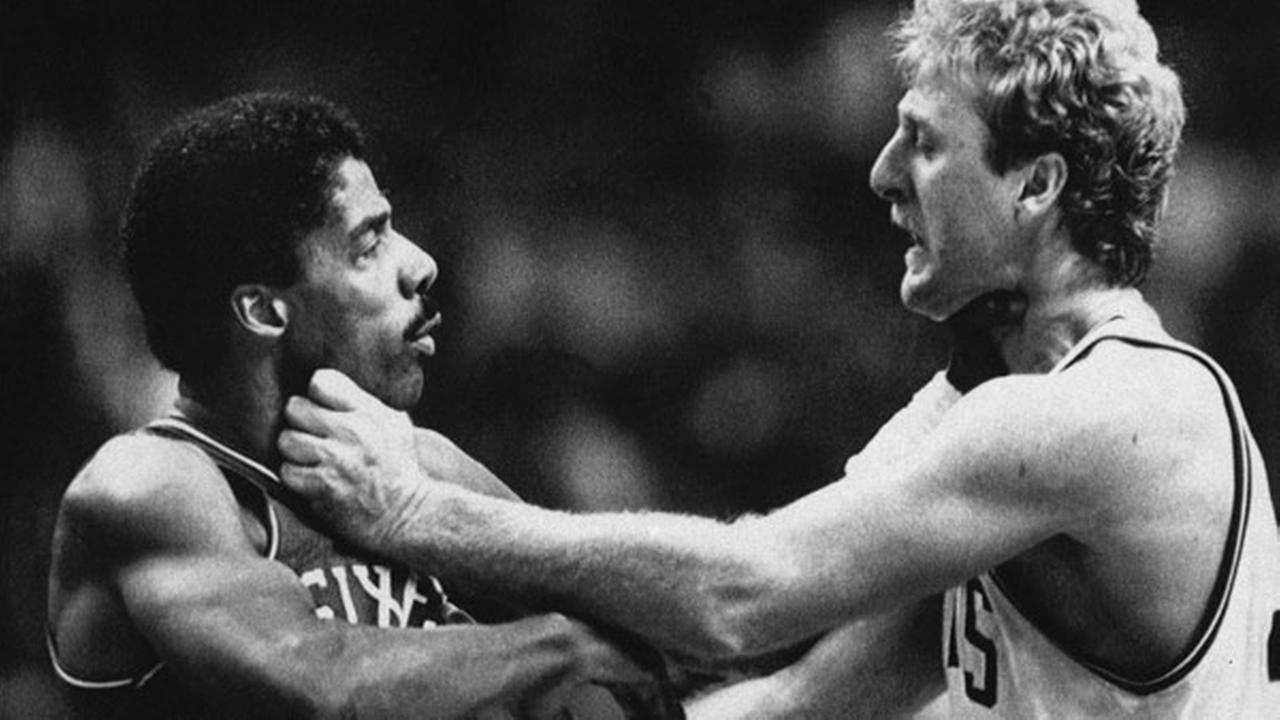 Philadelphia 76ers Julius Erving, left, and Boston Celtics Larry Bird square off during a second half fight at the Boston Garden, Nov. 9, 1984.