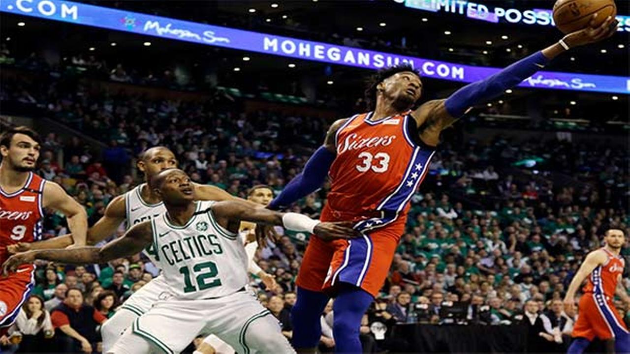76ers forward Robert Covington reaches for the ball against Celtics guard Terry Rozier in the first quarter of Game 1 of the second-round playoff series, Monday.