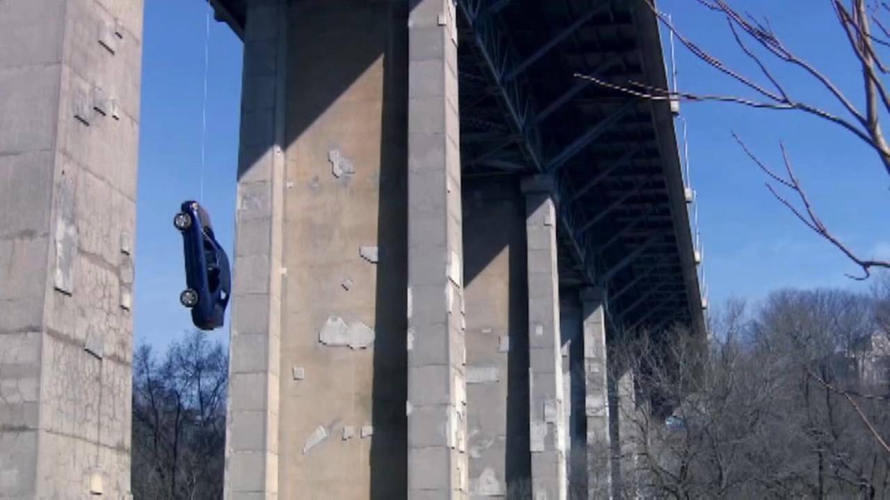 Car found dangling from Toronto bridge