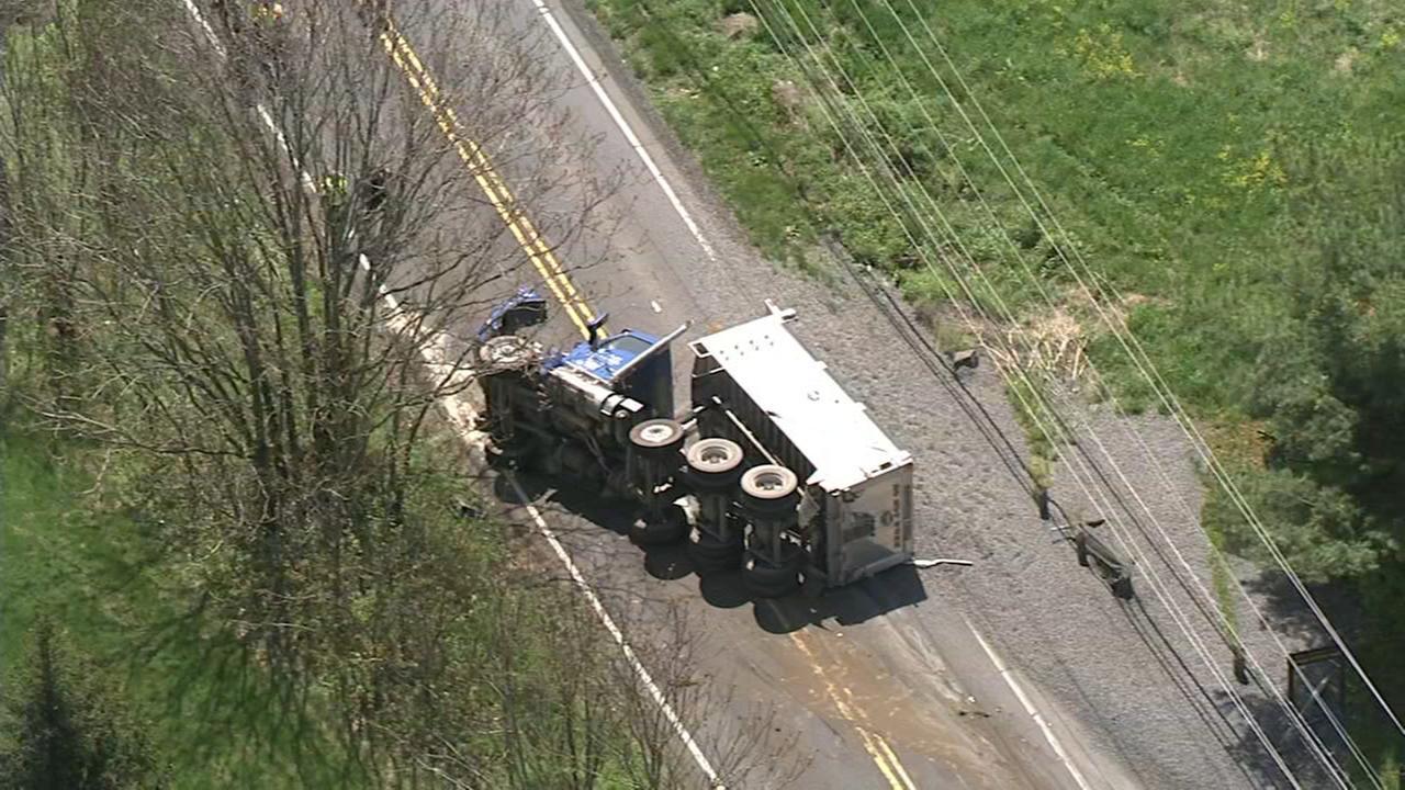 Dump truck flips on its side in Newtown Twp., Bucks Co. crash