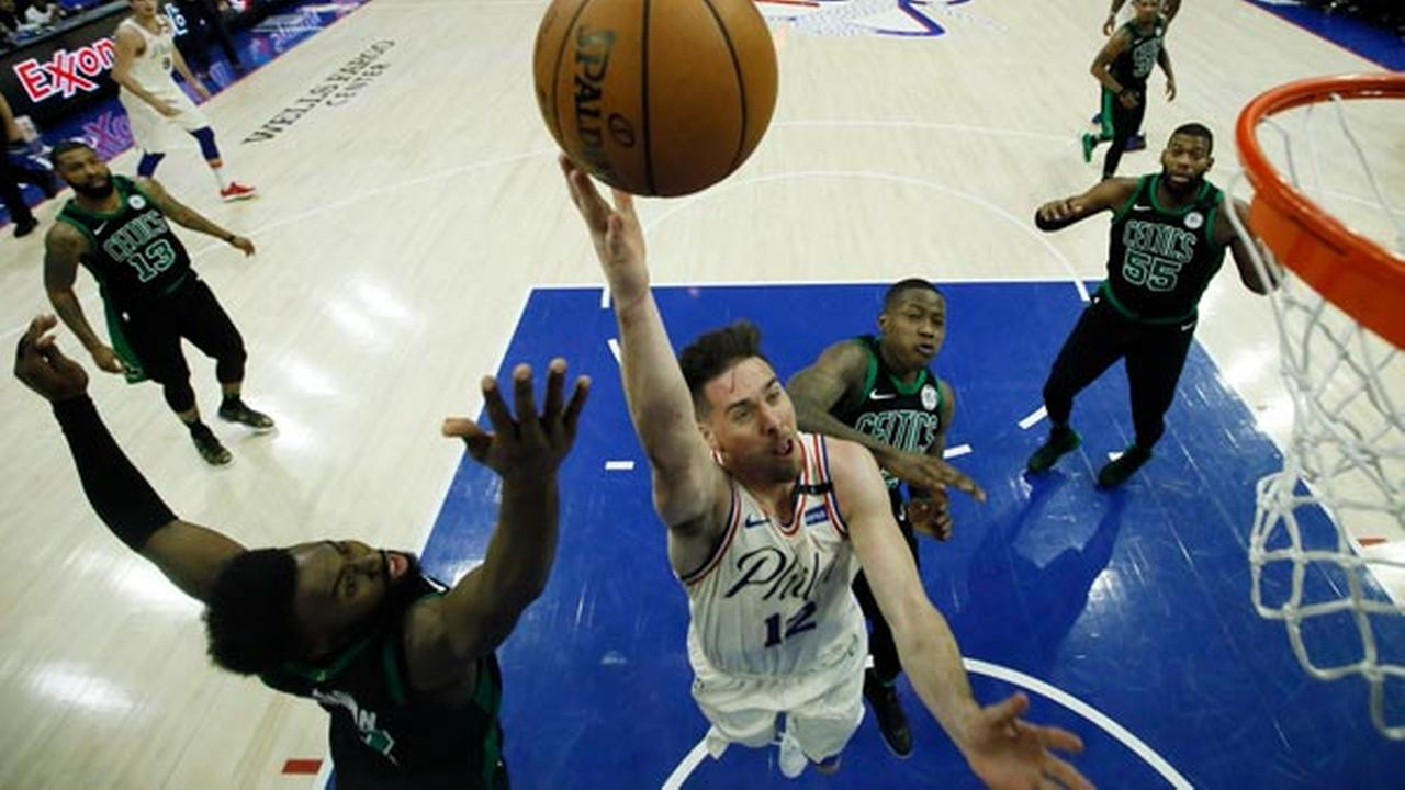 Philadelphia 76ers T.J. McConnell, center, goes up for a shot against Boston Celtics Jaylen Brown, left, and Terry Rozier during the second half of Game 4.
