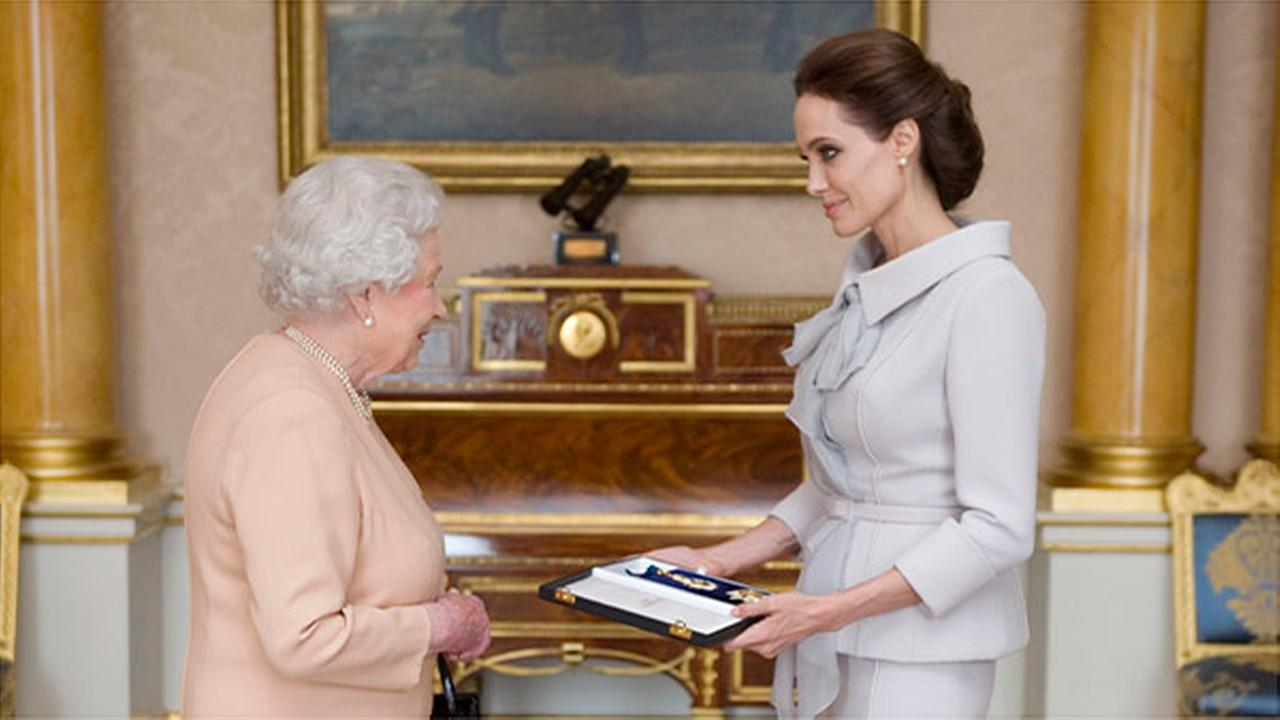 Queen Elizabeth honors Angelina Jolie at palace