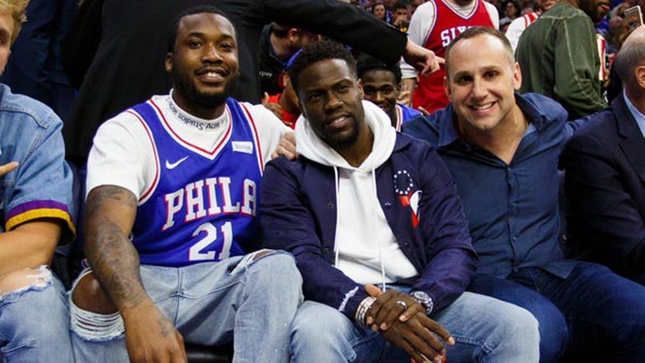 Rapper Meek Mill, left, looks on with actor Kevin Hart, center, and 76ers co-owner Michael Rubin, right, during the first half in Game 5 between the Heat and the 76ers.