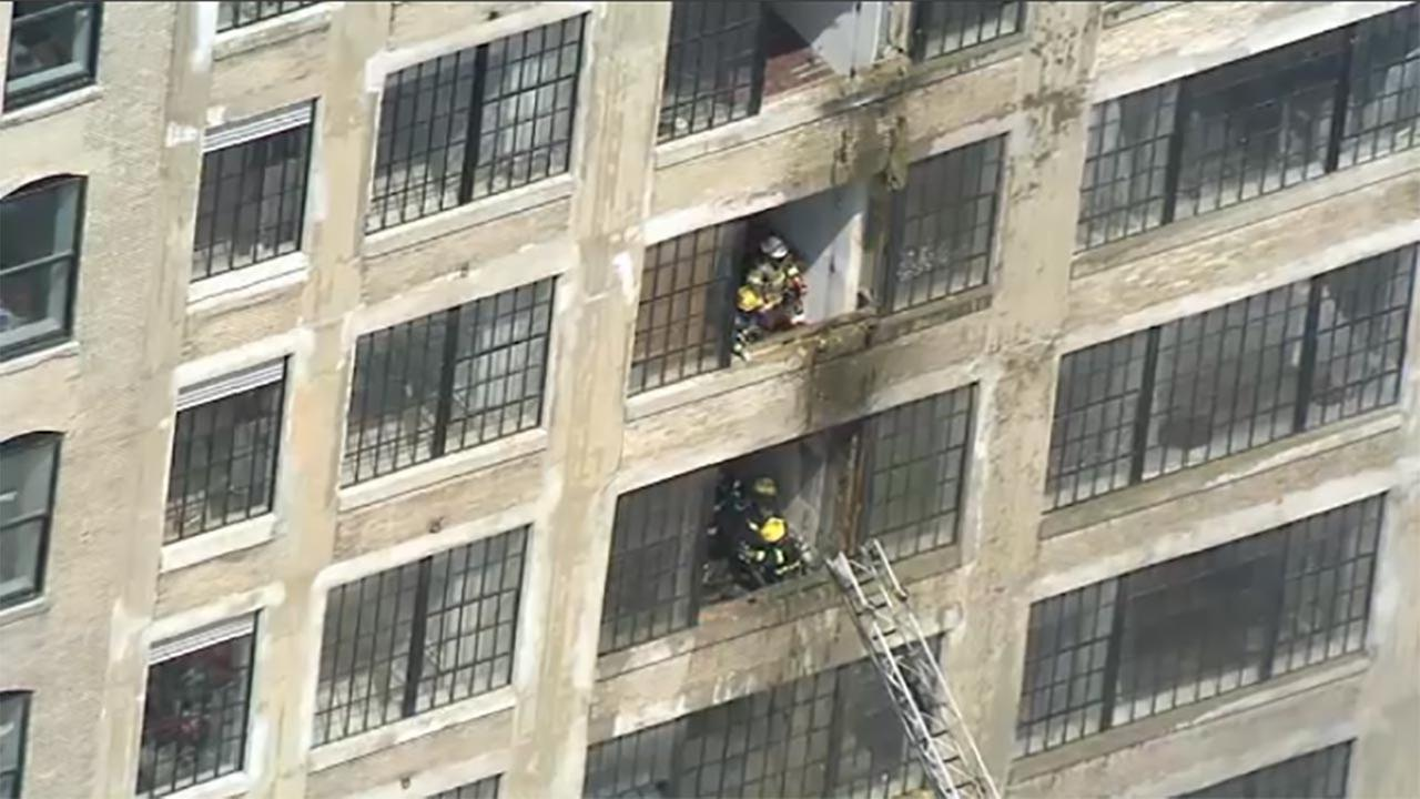 Rescuers respond to fire at apartment building in North ...