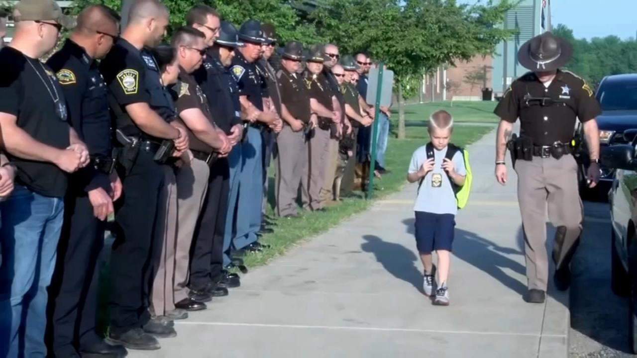 Officers take boy to school