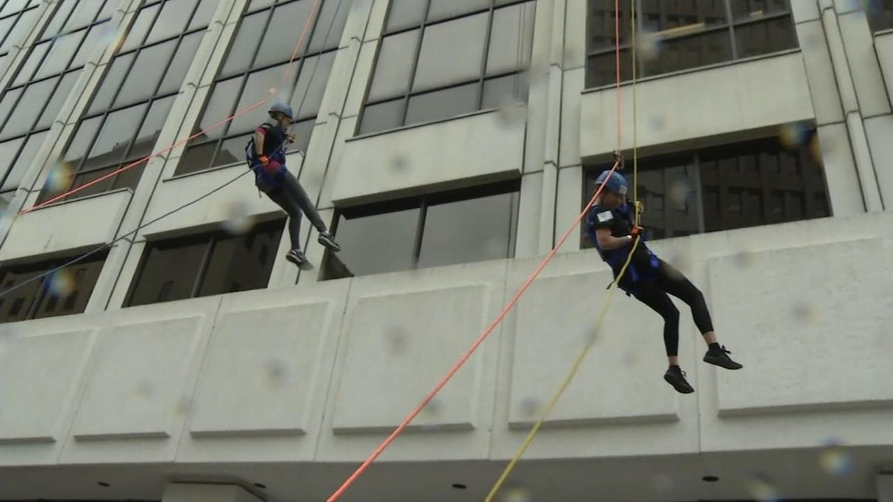 Folks rappel down Delaware building for charity