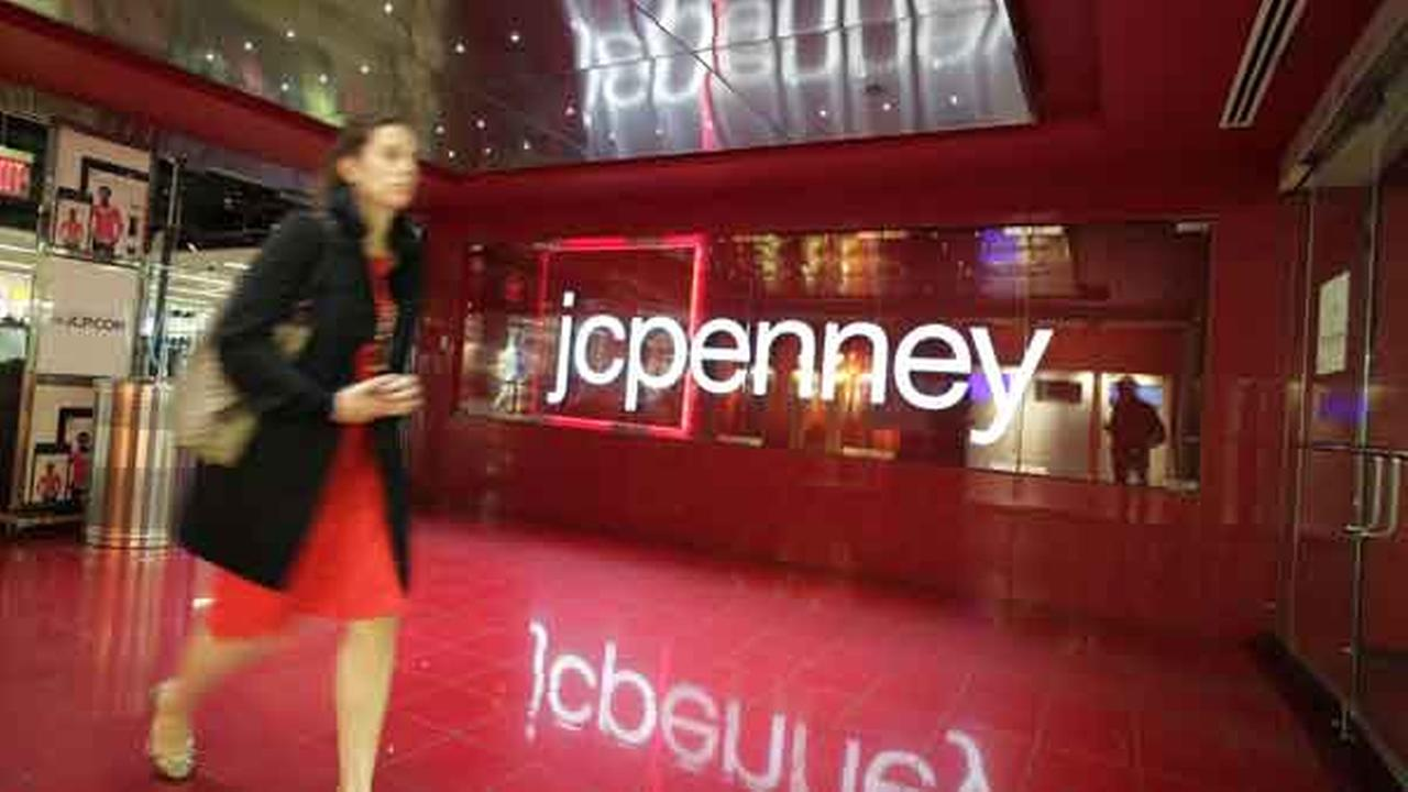 FILE - In this April 9, 2013 file photo, a customer leaves a JC Penney store in New York.