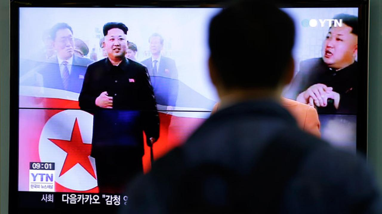 A man watches a TV news program showing North Korean leader Kim Jong Un using a cane during his first public appearance, at the Seoul Railway Station in Seoul, South Korea.